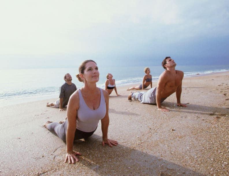 Surya-namashkar-yoga-pose-beach