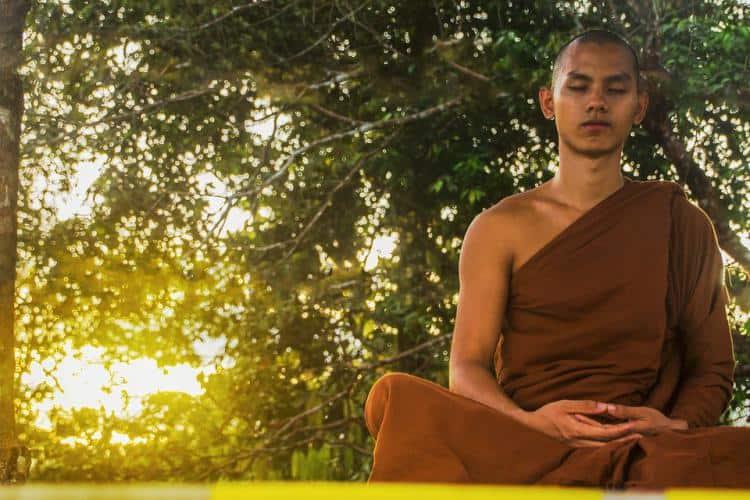 Buddhist-monk-chanting-meditation-om